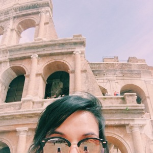 A photo of the author in front of the Colosseum